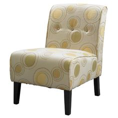 Button-tufted accent chair with exposed legs and wood framing.  Product: ChairConstruction Material: Hardwoods, ...