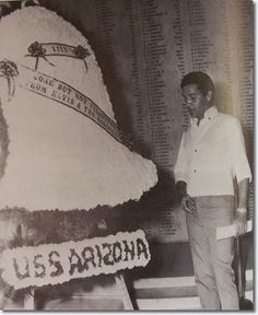 """Visiting The U.S.S. Arizona Memorial, August 15, 1965 - while on location in Hawaii for the movie """"Paradise Hawaiian Style,"""" Elvis, Vernon and Colonel Parker visit the U.S.S. Arizona memorial to lay a bell-shaped wreath designed by Colonel Parker and containing 1,177 carnations, one for every serviceman who lost his life aboard the ship. Photographers and reporters rushed in to record the event, but Elvis sent them away. He did not want his visit to the memorial to become a publicity stunt."""