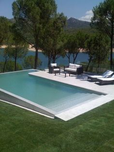 You will need to think of how you want to utilize your pool and weigh various design factors. Possessing a pool in your backyard may be excellent recreational avenue for the entire family. Whether you are searching for a backyard… Continue Reading → Pool Spa, Swiming Pool, Swimming Pools Backyard, Swimming Pool Designs, Pool Landscaping, Infinity Pool Backyard, Kids Swimming, Pool Steps Inground, Small Inground Pool