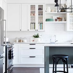 Bright white and modern kitchen design with dark details - Vanessa Francis Design. Featured on Design Sponge
