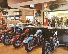 WOW a man cave bar with motorcycles for seats. Or bar ideA! Man Cave Garage, Garage Bar, Car Garage, Car Part Art, Biker Bar, Man Cave Accessories, Car Part Furniture, Furniture Design, Pipe Furniture