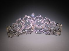 Created in 1936 by Cartier, the Halo Scroll tiara was purchased by Prince Albert for his wife, the Queen Mother Elizabeth.