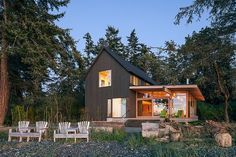 Orcas Island Retreat by Heliotrope Architects - modern farmhouse, sustainable construction, warm/dark wood siding, indoor/outdoor living