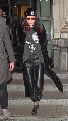 Staying on the dark side: The red streaks in her raven locks worked well with the rest of her ensemble, which consisted of a graphic brand tee and skin-tight PVC trousers