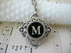 This is mine! Yes it is! Seriously...I got it in the mail today. I think I am in love.  Typewriter Jewelry - Necklace - Antique Typewriter Key - Letter Initial M