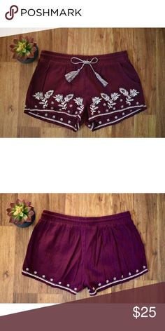 Floral Embroidered Shorts NWOT. Floral embroidery along entire bottom hem. Deep wine/burgundy color. Tassel drawstrings. One tassel is about 2in. longer than the other. Short shorts. Front pockets. No back pockets. Material: 100% cotton  •Cross posted   •Offers welcome Mudd Shorts