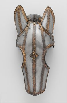 Some armour for horses, in particular Shafrons/ Shaffrons. They were normally made of metal and covered part or all of a horse's head. Common in the late Medieval to Elizabethan periods.