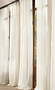 Gauzy scrim window curtains that puddle at the floor