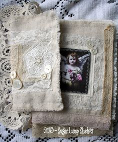 FAITH and ANGELS Altered Fabric Collage Book with vintage laces embellishments and beautiful rosary sugarlumpstudios via etsy