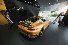 Discover the 911 Turbo S Exclusive Series live in front of the Porsche Museum in Zuffenhausen… and on our microsite from anywhere in the world. Take exclusive control of two camera-equipped robots and explore the highlights of this car. The images that you capture will be streamed live on our microsite. To you. And the whole world.  Learn more about this unique live experience: http://por.sc/HCT8q2    Combined fuel consumption in accordance with EU 6: 9.1 l/100 km, CO2 emissions: 212 g/km
