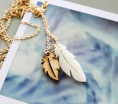 Feather Necklace SALE - Feathered White and Wood Pendants. $20.99, via Etsy.