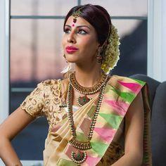 South Indian bride. Cream Kanchipuram silk sari with embellished contrast blouse.Temple jewelry. Braid with fresh flowers. Tamil bride. Telugu bride. Kannada bride. Hindu bride. Malayalee bride.