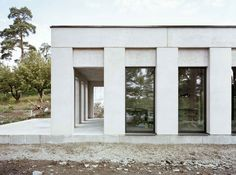 White piers and a colonnade lend a Classical aesthetic to the facade of House Skuru near Stockholm by Hermansson Hiller Lundberg Architecture Company, Classic Architecture, Contemporary Architecture, Architecture Details, Interior Architecture, Sustainable Architecture, Landscape Architecture, Architecture Classique, Neoclassical Architecture