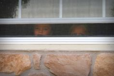 Instead of peeping in they are peeping out the window.