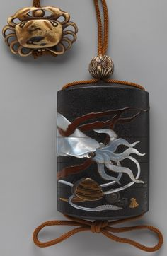 Case (Inrō) with Design of Squid, Shells and Seaweed. Artist:Hara Yōyūsai (Japanese, 1772–1845) Period:Edo period (1615–1868) Date:early 19th century Culture:Japan