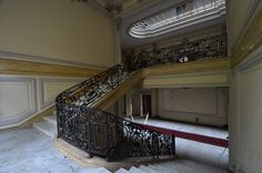 Grand staircase inside the abandoned Château Lumière in France.