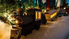 Seriously cute & so easy! Use old cookie boxes to create a Toy Train Town for under your tree! DIY by @kennethwingard!