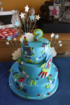 Rockets, Stars and Robots Cake for Logan's Naming Day Cake. Made by me :-) Find me on Facebook, where I share my recipes www.facebook.com/shinyrubbiepeople Or follow my blog on the website: www.shinyrubbiepeople.co.uk