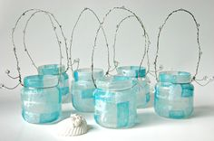 baby food jars, mod podge, tissue paper, wire, beads.... set of six for $25! @Jennifer Boatman