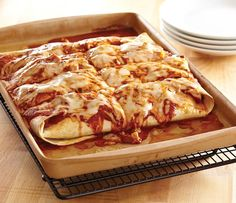 Re-pin this if you got new stoneware for the holidays! Break in your bar pan with our family-friendly enchilada recipe.