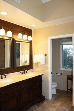 Master Bath traditional bathroom- double sink, dark cabinets, white trim, vaulted ceiling