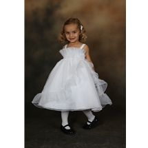 This adorable Sweetie Pie Collection baby flower girl dress style i429t has an organza bodice with ruffles at bust line and straps on shoulder. Full organza skirt with ruffle trim. www.SweetiePieCollection.com