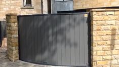 Curved automatic sliding gate in Scotland A gate we manufactured to the be able to slide around a curved wall to allow access to the driveway.A gate we manufactured to the be able to slide around a curved wall to allow access to the driveway. Fence Gate Design, Steel Gate Design, Front Gate Design, Main Gate Design, House Gate Design, Garage Door Design, Automatic Sliding Gate, Automatic Driveway Gates, Gates Driveway