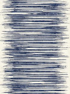 This sharp, designer rug uses a bold, modern design for an eye-catching effect, with hues of light cream and vivid indigo, and is hand knotted - see more