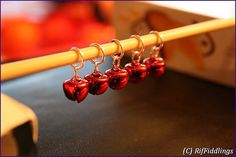 Set of jingle bell stitch markers by RifFiddlings, €4.00