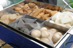 Oden is fish cake, fried tofu and vegetables simmered in a hot pot and available in most Japanese convenience stores