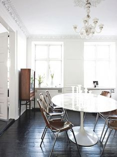 black glossy floor + white oval tulip + chandelier with medallion