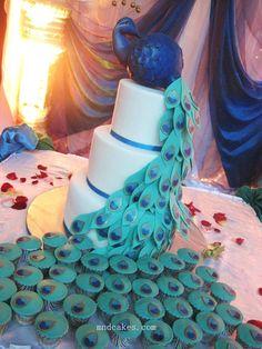 Peacock cake & matching cupcake tail.