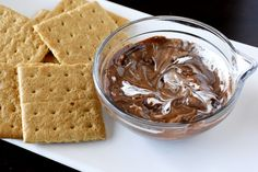 """S'mores Dip: 14 oz can of condensed milk, 1 c chocolate chips, c marshmellow cream, served with graham crackers. A bowl full of sugar, but a fun way to enjoy """"S'mores"""". Dessert Dips, Köstliche Desserts, Delicious Desserts, Dessert Recipes, Yummy Food, Tasty, Dip Recipes, Sweet Recipes, Yummy Recipes"""