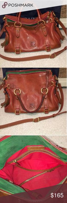 Dooney & Bourke Florentina Satchel Great condition. Leather is aging beautifully. Gold hardware. Lining does need to be cleaned. Some inks stains. But it's things that can be cleaned. The exterior is in better condition. This is the medium size.  Still up in the air if I want to sell this! This bag is beautiful. I am open to offers to trade. Dooney & Bourke Bags