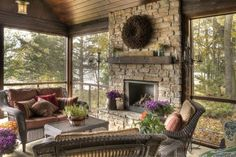 screened in porch with a fireplace