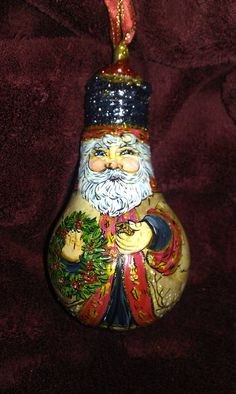 Hand Drawn & Painted Santa Light bulbs. Makes for a great ornament! on Etsy, $15.00