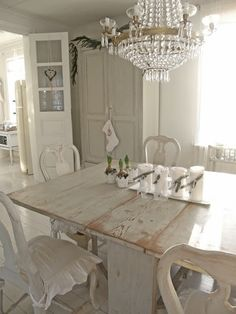 Light and simple-love the mix of styles yes all antique white with the exception of the crystal chandelier. A very attractive look-but please throw in a pop of color....