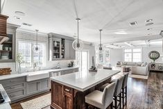 Love the gray cabinets and stained island