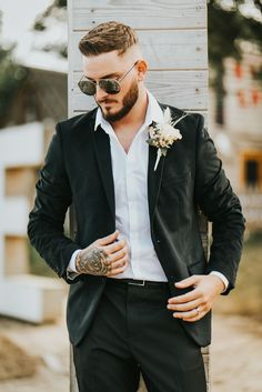 Groom in Black Wedding Suit with Blush Buttonhole | By Pearce Wedding Photography | Rock My Wedding | Fairground Wedding | Pink Wedding Flowers | Pink Wedding Decor | Outdoor Wedding | Alternative Wedding | Fun Wedding | Summer Wedding | Pastel Wedding Inspiration | Groom | Stylish Groom Wedding Pastel, Wedding Summer, Wedding Fun, Wedding Flowers, Black Suit Wedding, Wedding Suits, Pink Wedding Decorations, Flower Installation, Groomsmen Suits
