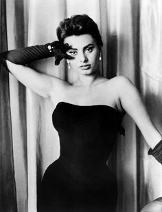 "Sophia Loren by unknown photographer, 1957  Sophia Loren, half length portrait, facing front, wearing a strapless dress and long gloves. NEA press photograph captioned ""Hollywood charmer: She made it in only seven years ..."", 11 June 1957."