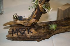 Here is an example of the  unique driftwood centerpieces that Matt and Katie Strand created out of driftwood.  They even used a branding iron to inscribe their initials.  I accented them with  flowers and succulents.The flowers included larkspur, eucalyptus, waxflower, eryngium and several types of succulents. Driftwood Wedding Centerpieces, Types Of Succulents, Branding Iron, Craft Fairs, Wild Flowers, Planter Pots, Cool Stuff, Create, Veronica