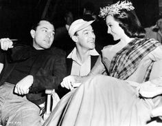 Tony Martin visits Gene Kelly and wife Cyd Charisse on the set of Brigadoon