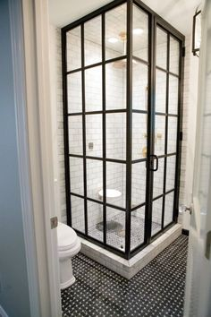 Glass panes in this phone booth-style shower.