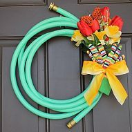 Made from a cheap garden hose and silk flowers - this Garden Hose #Wre… :: Hometalk