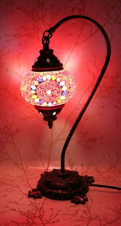 This Turkish Mosaic Lamp is made of hand-cut colored glass, and takes the shape of a swan neck - giving it yet more snazz than ever. More Turkish Mosaic Lamps Features - Size of the mosaic globe: 7 in