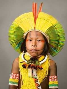 Kayapo boy wears an impressive display of feathers for his [very early by our standards] betrothal ceremony, a Kayapo rite of passage. The Kayapo are indigenous Indians of the Amazon basin, Brazil. © Martin Schoeller
