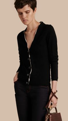 A V-neck cardigan shaped for a slim fit in Merino wool. A light layer to drape over dresses or denim, it has a tonal check accent at the sleeves.