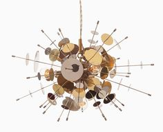 Avram Rusu Confetti Glass Pendant Light in Stainless Steel & Brass at DSHOP http://shop.thedpages.com/products/confetti-pendant-stainless-steel-brass