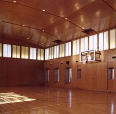 Private basketball court: This rift-sawn oak paneling & oak ceiling was finished in a custom color developed specifically for the owner and top coated in a satin sheen.