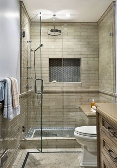 boys bathrooms Subway tile off white with grey grout Grey inlet and floor tiles Brown cabinets Simpler standard tile size in similar color Shower only with glass doors